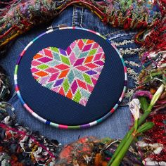 Looking for a romantic Valentines Day counted cross stitch pattern? This geometric heart cross stitch is full of color and has a modern design that will give cross stitch love to your wall this February. With 12 DMC floss colors, it's a heart xstitch embroidery pattern that you can