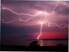 Lightning at Dusk - Spectacular electrical storms often spawn near the Louisiana coast. Lightning strikes the ground, above the clouds, and travels great distances through the clouds. Lightning Safety, Lightning Flash, Thunder And Lightning, Lightning Strikes, Thunderstorm And Lightning, Lightning Storms, Pictures Of Lightning, Lightning Photography, Wild Weather