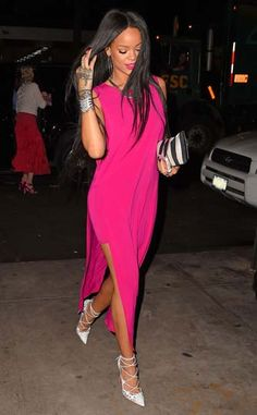 Rihanna hit the town in a hot pink Helmut Lang dress, Christian Louboutin heels, Lynn Ban jewelry and a Balmain clutch.