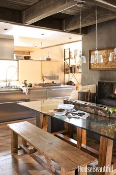 Modern Rustic Chic Kitchen  Dining Area next to fireplace. Lovely warm wood tones on floors: Best Kitchens of 2012 - Top Kitchen Designs - House Beautiful