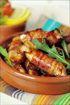 Bacon wrapped chicken bites (chicken breast) brushed with a honey dijon glaze.  Sounds good to me.....sign me up!