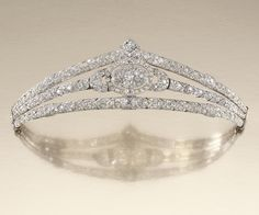 Circa 1919 diamond Diadem composed of a series of graduated chevron panels, centering on an oval plaque set between arched shoulders, embellished throughout with circular-cut and cushion-shaped diamonds, signed Paris, Londres and numbered; later fitted case by Antrobus, 6-8 Old Bond Street, London, W1.