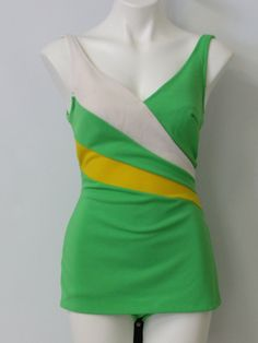 Early 70s -JCPenney- Womens bright green, white and yellow banded diagonal stripe design double knit polyester one piece mod swimsuit with made to look cross over v-neckline and skirted front hem with boy short brief underlay.