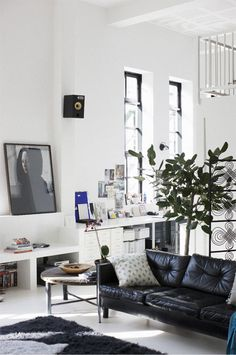 Everything eye level makes this room, with its high white ceilings, comfortable and inviting