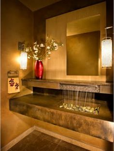 Enlightenment comes in the strangest of places-why not your Powder Room? The golden tones and river rock waterfall fountain are so inviting! From Our Design Connection, Inc. Blog | Kansas City Interior Design