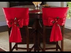 Red Holiday Bow Dining Chair Back Covers Set of 2 red dining chair back covers feature a satiny finish and Christmas poinsettia in the center of the bow Price 1499 Link Red Dining Chairs, Dining Chair Slipcovers, Cafe Chairs, Kitchen Chairs, Upholstered Chairs, Chair Cushions, Dining Room, Chair Back Covers, Chair Backs