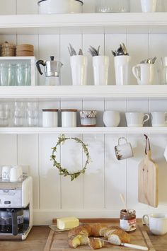 open white kitchen shelves with white and glass kitchenwares and wreath Rustic Kitchen, Country Kitchen, Kitchen Dining, Kitchen Ideas, Dining Room, Painting Kitchen Cabinets, Kitchen Shelves, Cupboards, Small White Kitchens