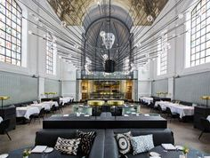 If you enjoyed the amazing 700-year-old Boekhandel Selexyz Dominicanen converted church in Maarstricht, you'll love this ornate chapel turned chic restaurant in Antwerp, Belgium.