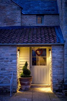 Exterior of Cottage front door with heart wreath and plotted plant Barn Renovation, Converted Barn, House Front, Cottage Door, Front Door, Exterior Doors, Cottage Interiors, Cottage Front Doors, Doors