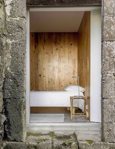 Interiors are enveloped in wood and concrete, with furnishings made of local criptoméria wood