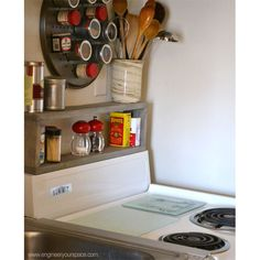 DIY shelf above the stove = extra storage in a small kitchen