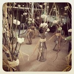 twigs and paper flower centerpieces...these are what I've been looking for!!!!!!! Going in between my three mason jar candles!