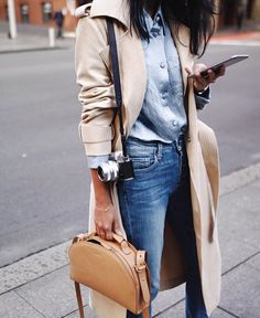Trench coat and denim shirt with jeans