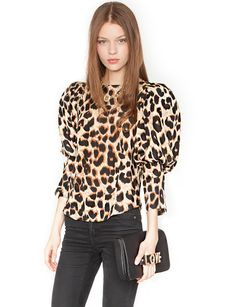 Got the need for high glam? Look no further than this leopard puffy sleeve blouse, $69.00 at Pixiemarket.