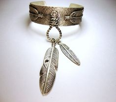 Silver Cuff Bracelet with Feather Charm Dangle // 925 sterling silver cuff bangle hippie chic trendy native american indian feather boho statement tribal tribe bangle spirit jewelry bohemian bold hippy womens woman ladies cowboy and indian cow boy lasso feather charm oxidized silver etsy  https://www.etsy.com/ca/listing/183051710/silver-cuff-bracelet-with-feather-charm