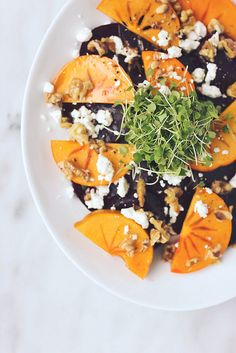 Roasted Beet and Persimmon Salad with Goat Cheese and Toasted Walnut Vinaigrette // Tasty Yummies