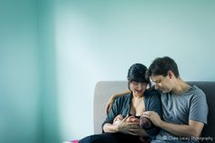 Making use of natural warm light, couple and their newborn baby girl sitting on their bed http://cjlacey.co.uk/blog/ #baby #ideas #newborn