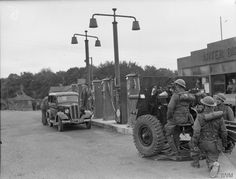 A 25-pdr field gun ready to fire from a rather perilous position alongside the pumps at a petrol station, during exercises in Kent, 13th October 1941