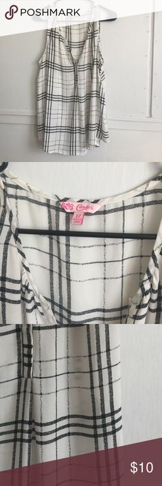 Black and white plaid chiffon blouse Easy to dress up or down this top is a must for any workin' woman's closet. I went a size up for tucking in to pencil skirts or slacks. Cute with a cardigan or blazer, or by its self. Tiny speck on front (pictured) Candie's Tops Blouses