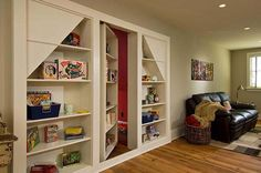 """2.) Hide toy clutter with a hidden game room. .. ALL of these """"secret or hidden"""" rooms are amazing.  My dream house will have one :))"""