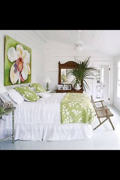 TRoPiCaL BeDRooM ____The dark stained dresser stands out in this white room