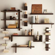 How to decorate floating shelves interestingly: charming floating shelves on white wall with small decorative books bottle earthenware and other good artworks