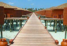 Maldives - Meeru-island-resort - Walkway to bedroom, crock pots of water to wash away the sand on your feet. Honeymoon memories!