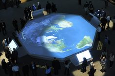 In the center of Sapphire Now's Innovation Showcase, SAP demonstrated its work with airline and shipping companies on a large digital map. Airplanes and ships appeared to travel around the world based on data attendees selected on four adjacent touch screens. Photo: Courtesy SAP