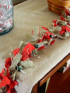 Tie strips of burlap to christmas lights! (Use this instead as the garland/lights on the trees)  --- do this in advance/later