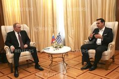 DATE IMPORTED:27 May, 2016Greek Prime Minister Alexis Tsipras (R) talks with Russian President Vladimir Putin during their meeting in Athens on 27 May 2016. REUTERS/Orestis Panagiotou/Pool