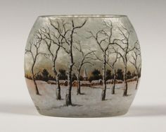 A Daum Nancy enamelled cameo glass winter landscape vase, circa 1905, of oval form, decorated with a continuous snowy scene.
