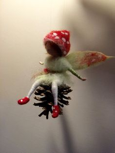Small forest elf is on a pine cone. The hat and the shoes are the same color as the bright forest mushroom Amanita. The height of the entire composition is 4,5 . It will be a beautiful scenery in every corner of your home or ... unusual gift. Thank you for visiting my store.