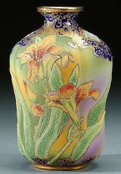 A NIPPON CORALENE DECORATED PORCELAIN VASE CIRCA 1909 BEADED GLASS DECORATION OF LILIES ON A GREEN, PURPLE AND AMBER SATIN FINISH WITH A COBALT BLUE RIM
