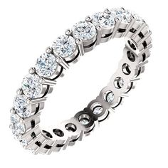 14K white gold diamond eternity band. The ring holds 22 round brilliant cut diamonds with total weight of approximately 1.75ct. The diamonds are graded as VS in clarity G-H in color.