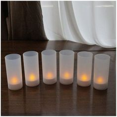 Flameless candles give the warm inviting glow of a fire without the actual danger of an open flame. Candles sit inside of frosted white votive holders. Amber flame with realistic flicker. Convenient on/of Flameless Candles With Remote, Scented Pillar Candles, Bulk Candles, White Candles, Led Candles, Candle Set, Candle Jars, Luminara Candles, Window Candles