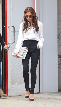 Victoria Beckham was the epitome of minimalist style in this sleek white blouse.