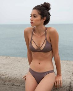 The RVCA Solid Strappy Bralette Bikini Top is a bralette-style swim top with crossed straps at the bust and a racerback design with intricate crossed st...
