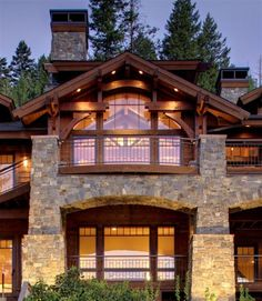 This could easily be the best front to my dream log cabin.   stone, wood, exposed beams...