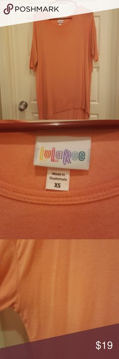 Lularoe irma xs Peach color, worn a few times, slight piling under arms but not obvious in my opinion lularoe Tops