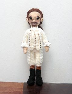 12 inch Crochet Alexander Hamilton 1800s Style Amigurumi Art Doll. Pattern based on the Hamilton Musical.  This adorable crochet doll has a 19th century style about him. I especially love the brass buttons on his jacket. He has rosy cheeks a little bit of a smirk, and his arms and legs are pose-able. He stands between 12-13 tall. Each doll will vary slightly.   The doll is mostly 100% acrylic yarn and stuffed with polyfil (polyester fiber fill/pillow stuffing). He is created in a smoke f...