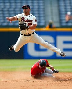 July 1 - WSH at ATL - Ryan Zimmerman is thrown out by Dan Uggla in the 9th inning.