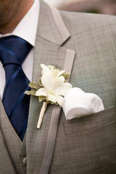 gray suit, navy tie