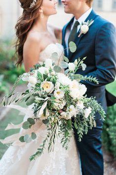 Garden-style wedding bouquet idea - loose, greenery wedding bouquet with white flowers {Anik Flowers}