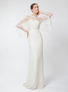 Ivory paillette bridal gown, straight-cut with hand-knitted lace bolero, crew neck and double sleeves.