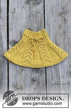 Nederdel med hulmønster og hæklekant til børn, strikket ovenfra og ned. Størrelse 2 - 12 år. Arbejdet er strikket i DROPS Merino Extra Fine