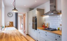 grey shaker style kitchen with wooden worktops House grey shaker style kitchen with wooden worktops. Small Kitchen Diner, Grey Shaker Kitchen, Galley Kitchen Design, Small Galley Kitchens, Kitchen Layout, Rustic Kitchen, New Kitchen, Home Kitchens, Gally Kitchen