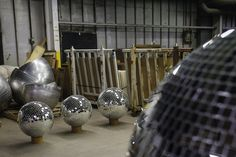 Finished disco balls, two 20-inch and one 22-inch, on the factory floor.
