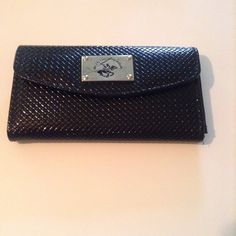 ❗️ON SALE❗️Beverly Hills Polo Club wallet Beverly Hills Polo Club black wallet. Front compartment has snap closure. Inside front compartment is a small center zipper pouch and on one side is slots for your credit cards. The other side of the wallet has a twist closure and can hold your coins.  The wallet is almost perfect, except for a couple small imperfections on the emblem that appears as small smudges that are barely noticeable. The rest of the wallet is in great shape.  The wallet is…