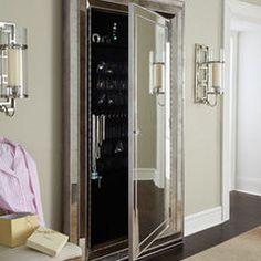 Leaner mirror/jewelry holder combo.