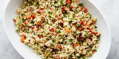 This easy basic recipe for rice salad comes from Mark Bittman's How to Cook Everything Vegetarian. Turning it into an side dish for Japanese, Mexican, or Indian dinners is as simple as following one of the many variations.